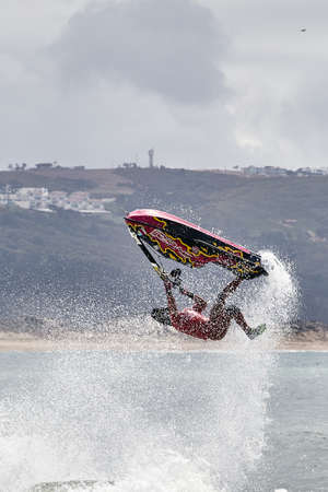 Professional jet ski riders compete at the IFWA World Tour Jet Ski Championship. Contestants perform tricks for judges in the waves. Freeride World Championship IFWA. 27.04.2018, Nazare, Portugal Banque d'images - 139965208