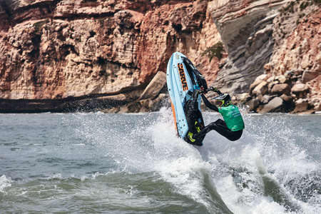 Professional jet ski riders compete at the IFWA World Tour Jet Ski Championship. Contestants perform tricks for judges in the waves. Freeride World Championship IFWA. 27.04.2018, Nazare, Portugal Banque d'images - 139965216