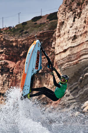 Professional jet ski riders compete at the IFWA World Tour Jet Ski Championship. Contestants perform tricks for judges in the waves. Freeride World Championship IFWA. 27.04.2018, Nazare, Portugal Banque d'images - 139965218