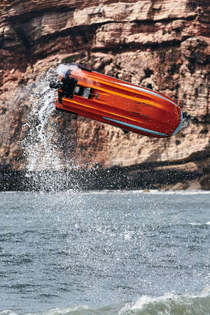 Professional jet ski riders compete at the IFWA World Tour Jet Ski Championship. Contestants perform tricks for judges in the waves. Freeride World Championship IFWA. 27.04.2018, Nazare, Portugal Banque d'images - 139965220