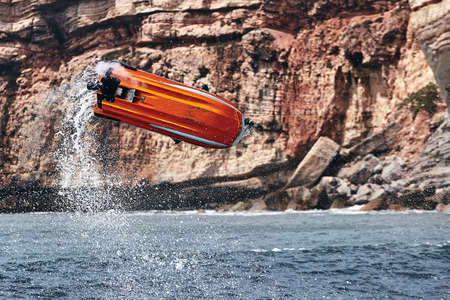 Professional jet ski riders compete at the IFWA World Tour Jet Ski Championship. Contestants perform tricks for judges in the waves. Freeride World Championship IFWA. 27.04.2018, Nazare, Portugal Banque d'images - 139965224