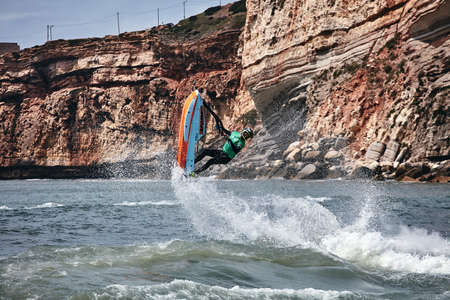 Professional jet ski riders compete at the IFWA World Tour Jet Ski Championship. Contestants perform tricks for judges in the waves. Freeride World Championship IFWA. 27.04.2018, Nazare, Portugal Banque d'images - 139965222