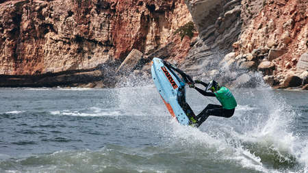 Professional jet ski riders compete at the IFWA World Tour Jet Ski Championship. Contestants perform tricks for judges in the waves. Freeride World Championship IFWA. 27.04.2018, Nazare, Portugal Banque d'images - 139965225