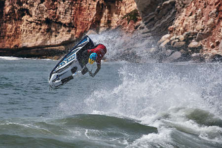 Professional jet ski riders compete at the IFWA World Tour Jet Ski Championship. Contestants perform tricks for judges in the waves. Freeride World Championship IFWA. 27.04.2018, Nazare, Portugal Banque d'images - 139965232