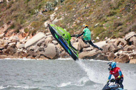 Professional jet ski riders compete at the IFWA World Tour Jet Ski Championship. Contestants perform tricks for judges in the waves. Freeride World Championship IFWA. 27.04.2018, Nazare, Portugal Banque d'images - 139965237