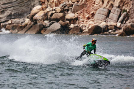 Professional jet ski riders compete at the IFWA World Tour Jet Ski Championship. Contestants perform tricks for judges in the waves. Freeride World Championship IFWA. 27.04.2018, Nazare, Portugal Banque d'images - 139965241