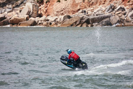 Professional jet ski riders compete at the IFWA World Tour Jet Ski Championship. Contestants perform tricks for judges in the waves. Freeride World Championship IFWA. 27.04.2018, Nazare, Portugal Banque d'images - 139965245