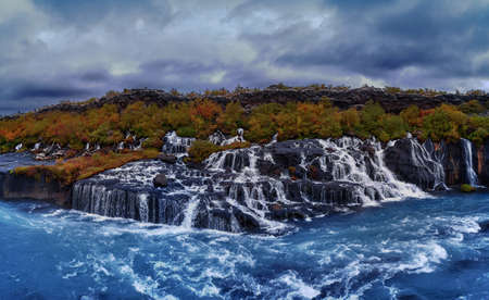 Hraunfossar Waterfall. Lava waterfalls. waterfall flowing down from the lava fields on the canyon of the hvita river, Iceland. Stock Photo