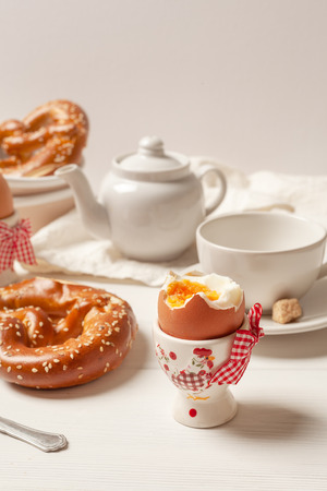 Rustic Breakfast. Boiled eggs and pastries on white wooden background.  The concept of a homemade Breakfast. Place for text. Side view