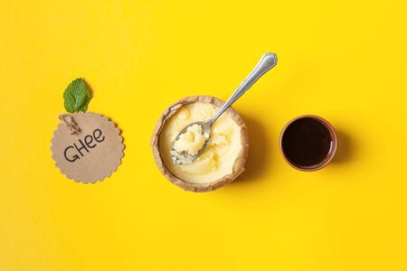 Coffee with organic Ghee oil in a white ceramic Cup. Keto diet. Ayurveda. Oil elixir Stock Photo