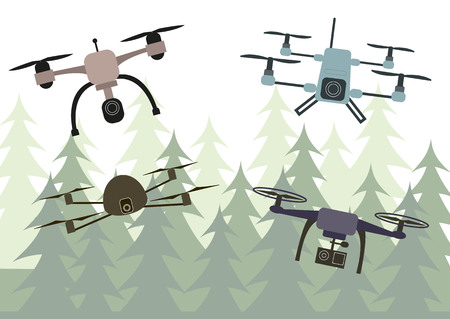 Flying drones on the forest background.