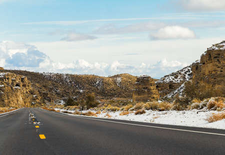 Asphalt Road between mountains in Southern Nevada, USA Stock Photo