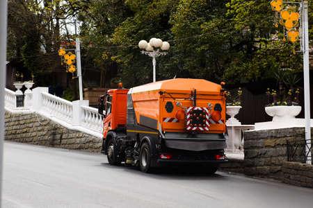 Cleaning machine washes asphalt road surface the city street Standard-Bild
