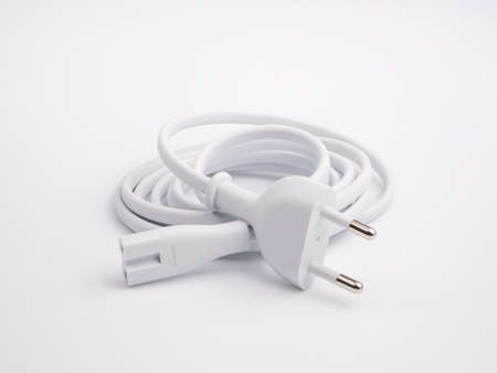White power cable with plug and socket on white background Фото со стока
