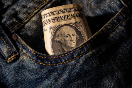 Portrait of a Washington peeps out of his jeans pocket, a dollar bill. Close up, details. Stock Photo