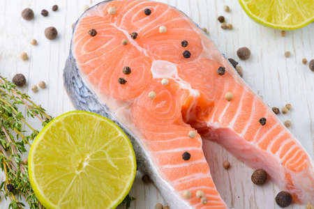 fresh salmon with pepper, thyme and lime. close-up photo