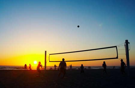 stamina: Family playing beach volleyball Stock Photo