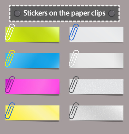 Multicolored stickers on paper clips.
