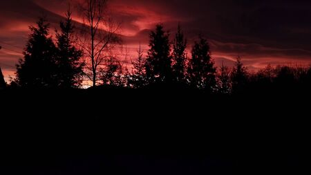 The view from the heights of a beautiful dramatic red sunset in the Khimni years Banco de Imagens