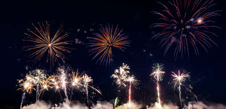 Colorful fireworks of vaus colors over night sky Stock Photo - 22496620