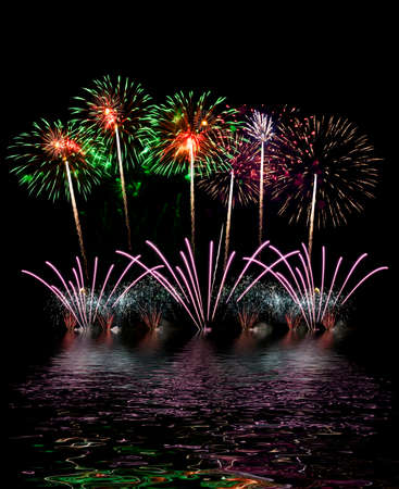 Colorful fireworks of various colors over night sky, fireworks on the beach