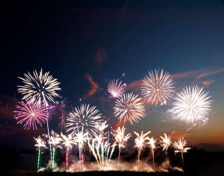 Colorful fireworks of various colors over night sky photo