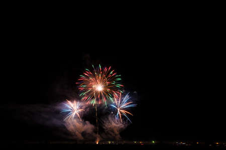 Colorful fireworks of various colors over night sky Stock Photo - 22497139