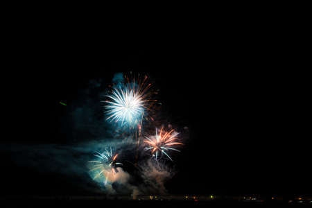 Colorful fireworks of vaus colors over night sky Stock Photo - 22497141