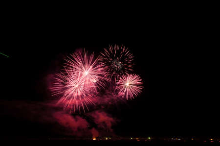 Colorful fireworks of various colors over night sky Stock Photo - 22497156