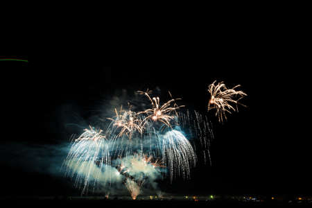 Colorful fireworks of various colors over night sky Stock Photo - 22497157