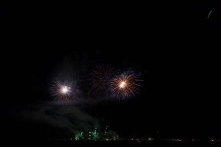 Colorful fireworks of various colors over night sky Stock Photo - 22497171