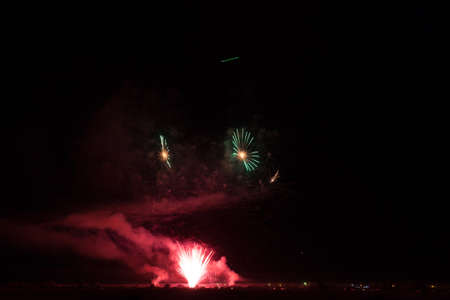 Colorful fireworks of various colors over night sky Stock Photo - 22497204