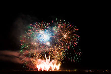 Colorful fireworks of various colors over night sky Stock Photo - 22497255