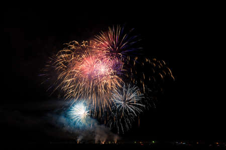 Colorful fireworks of vaus colors over night sky Stock Photo - 22497258