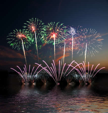 Colorful fireworks of various colors over night sky, fireworks on the beach photo