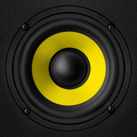 oscillations: Black   yellow speaker with a metal membrane Stock Photo