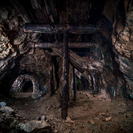Wooden pillars in the old mine Stock Photo