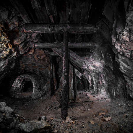 wooden pillars in the old mine Stock Photo