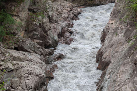 White River in the granite gorge, Republic of Adygea, pollution, agriculture, consequences of the landslide, mudslide