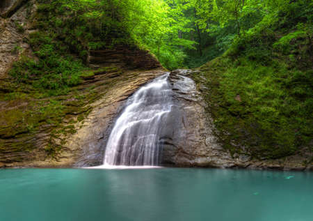 tropical waterfall, falls on the river meshoko, Republic of Adygea, HDR