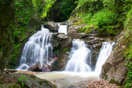 Waterfall in the river valley Syk Stock Photo