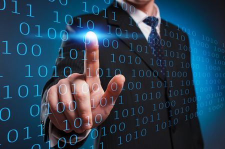 Virtual multimedia display. A man in a suit and tie clicks his index finger on the virtual screen