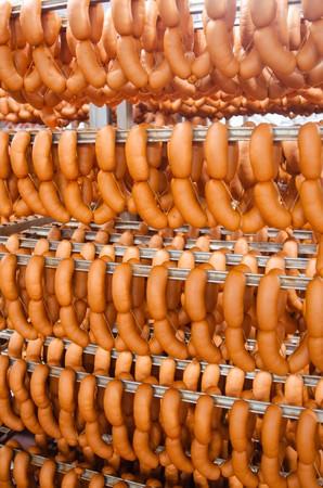 Sausage. Sausage production line. Sausage on the counter for the smokehouse. Industrial manufacture of sausages.