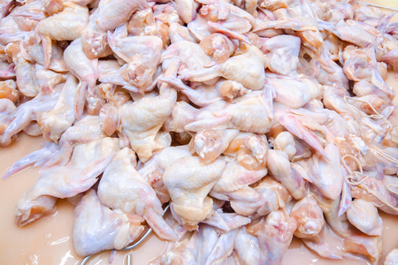 Chicken. Line of production of chicken delicacies. Smoked delicacy factory.