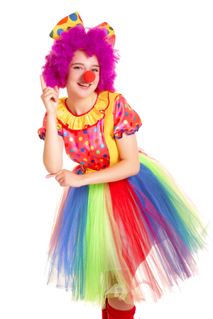 Happy young clown girl on white background. 스톡 콘텐츠