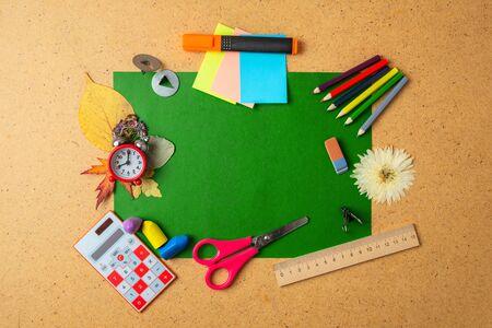 Back to school concept. Alarm clock and school supplies. Copy space.