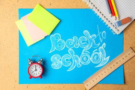 Back to school concept. School supplies with chalk inscription. Reklamní fotografie