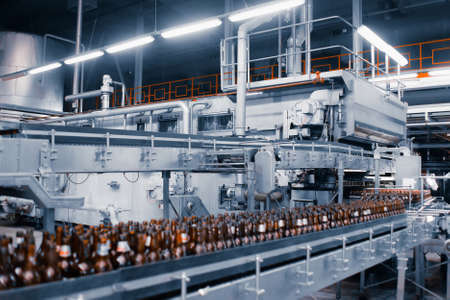 Bottle washing sterilization machine. Glass bottle washing line in a brewery