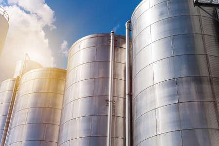 Rows of aluminum tanks against the sky. Modern elevator. Banco de Imagens