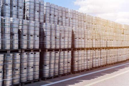 Rows of beer kegs. Large warehouse of beer kegs